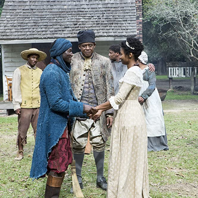 Forest Whitaker, Emayatzy Corinealdi, and Malachi Kirby in Roots (2016)