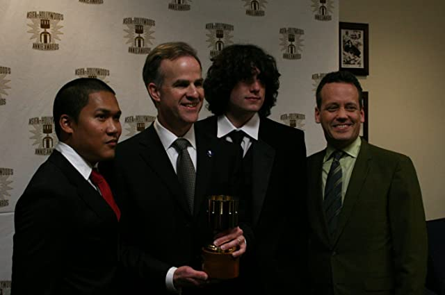 Dante Basco (l), Jack De Sena (3rd from l), Dee Bradley Baker (r) present Harley Jessup with the award for feature production design.