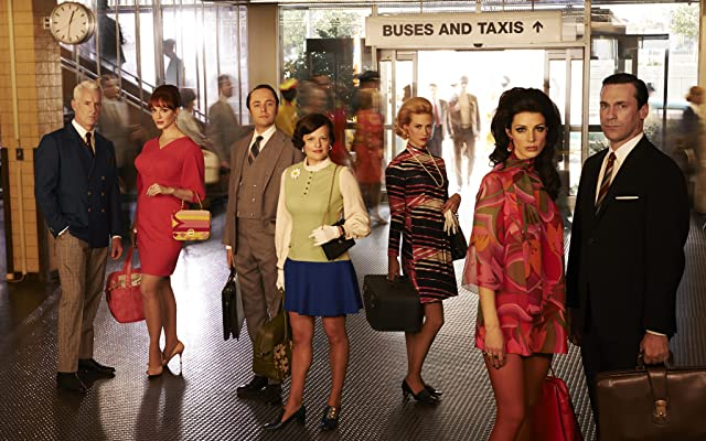 January Jones, Elisabeth Moss, Jon Hamm, Christina Hendricks, Vincent Kartheiser, Jessica Paré, and John Slattery in Mad Men (2007)