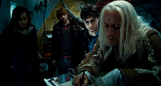 Rupert Grint, Rhys Ifans, Daniel Radcliffe, and Emma Watson in Harry Potter and the Deathly Hallows: Part 1 (2010)