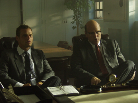 Justin Chambers and Rex Linn in The Zodiac (2005)
