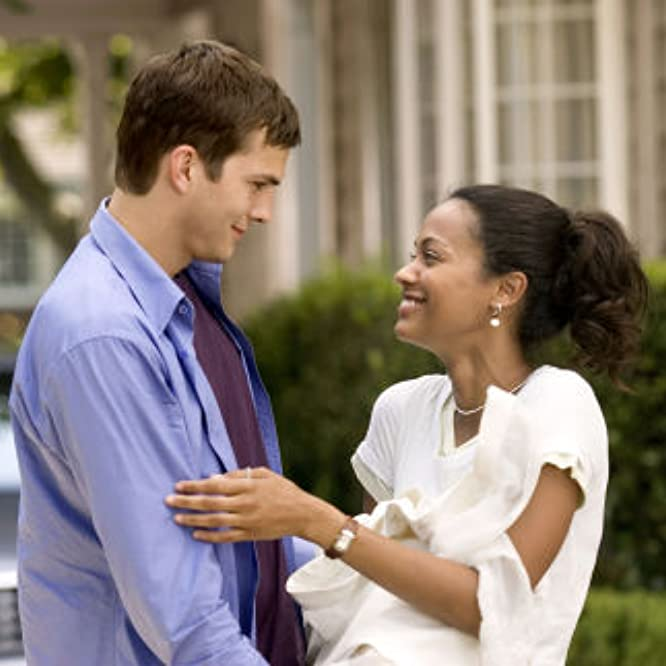 Ashton Kutcher stars in Columbia Pictures/Regency Enterprises' new comedy Guess Who. Ashton Kutcher (l) and Zoë Saldaña star in Columbia Pictures/Regency Enterprises' new comedy Guess Who.