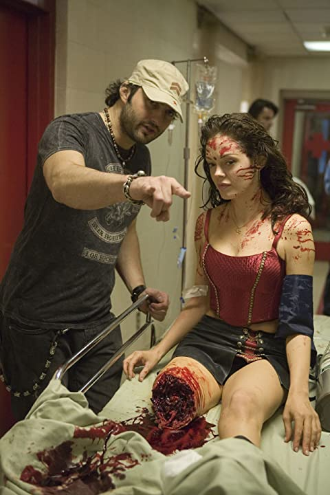 Rose McGowan and Robert Rodriguez in Grindhouse (2007)
