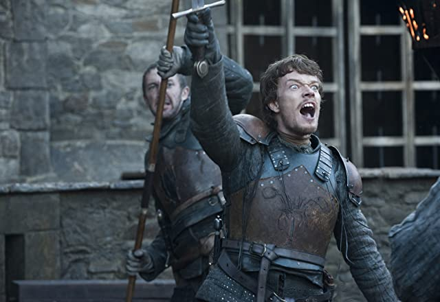 Ralph Ineson and Alfie Allen in Game of Thrones (2011)