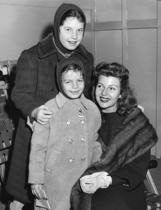 Rita Hayworth with daughters Rebecca Welles and Yasmin Khan arriving in New York City