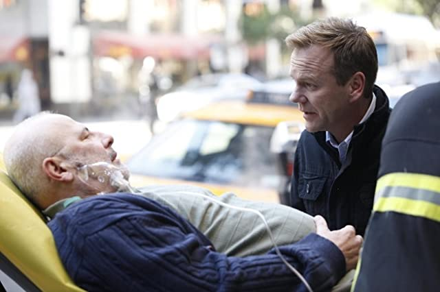 Kiefer Sutherland and Jude Ciccolella in Touch (2012)