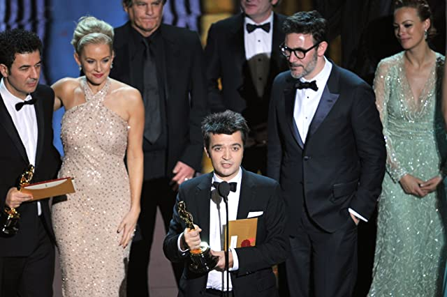 Penelope Ann Miller, Ludovic Bource, Michel Hazanavicius, and Thomas Langmann at The 84th Annual Academy Awards (2012)