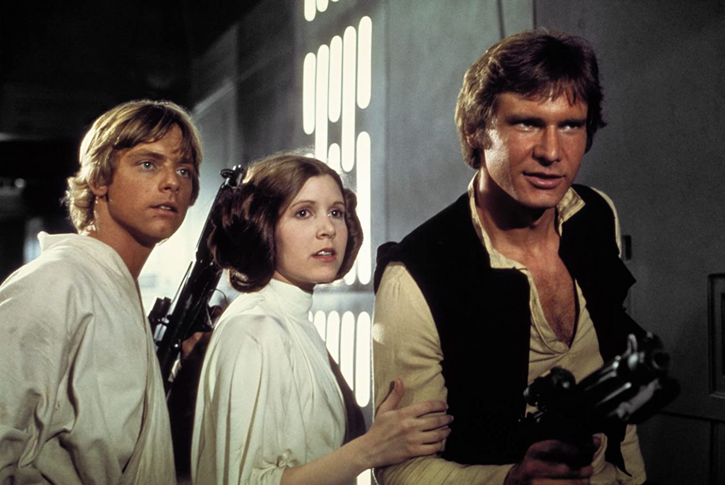 Harrison Ford, Carrie Fisher, and Mark Hamill in Star Wars (1977)