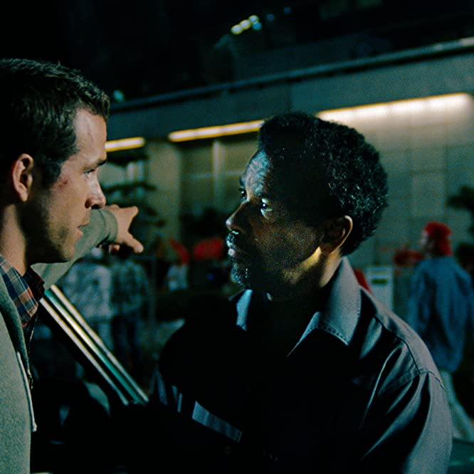 Denzel Washington and Ryan Reynolds in Safe House (2012)