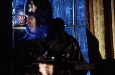 Marvin Campbell is the infected peering through the window at Luke Mably (front).