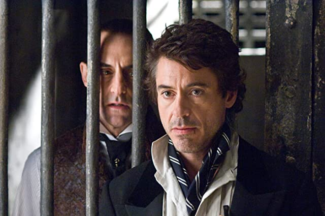 Robert Downey Jr. and Mark Strong in Sherlock Holmes (2009)