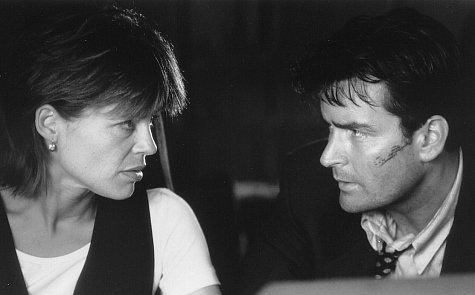 Linda Hamilton and Charlie Sheen in Shadow Conspiracy (1997)