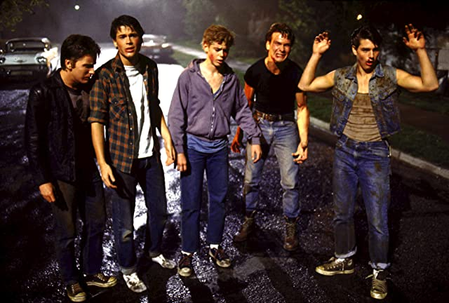 Tom Cruise, Emilio Estevez, Rob Lowe, Patrick Swayze, and C. Thomas Howell in The Outsiders (1983)