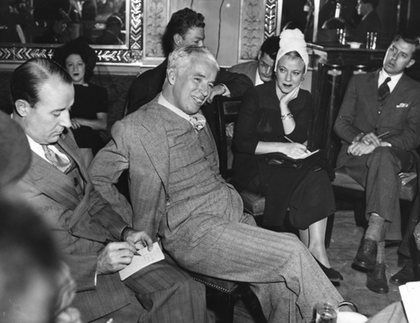 Charlie Chaplin at a press conference for the premiere of