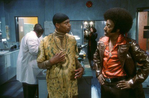 Dave Chappelle and Eddie Griffin in Undercover Brother (2002)