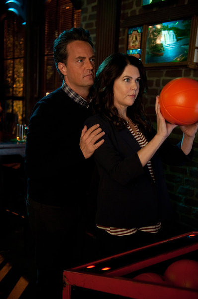 Matthew Perry and Lauren Graham in Go On: Dinner Takes All (2012)
