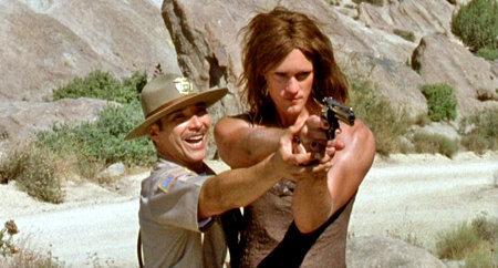 Officer Jones (Benito Martinez) and Geert (Alexander Skarsgard) in 'Kill Your Darlings'. Dir: Bjorne Larson