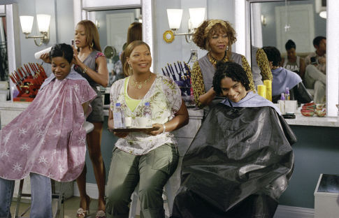 QUEEN LATIFAH (center), GOLDEN BROOKS (left-back), and ALFRE WOODARD (right-back) star as Gina, Chanel, and Ms. Josephine in MGM Pictures' comedy BEAUTY SHOP.