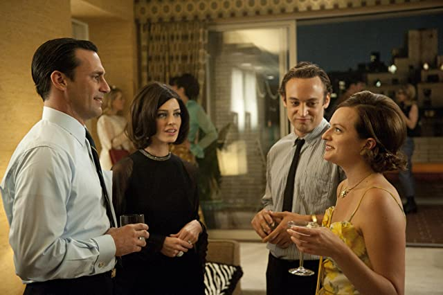 Elisabeth Moss, Jon Hamm, Charlie Hofheimer, and Jessica Paré in Mad Men (2007)