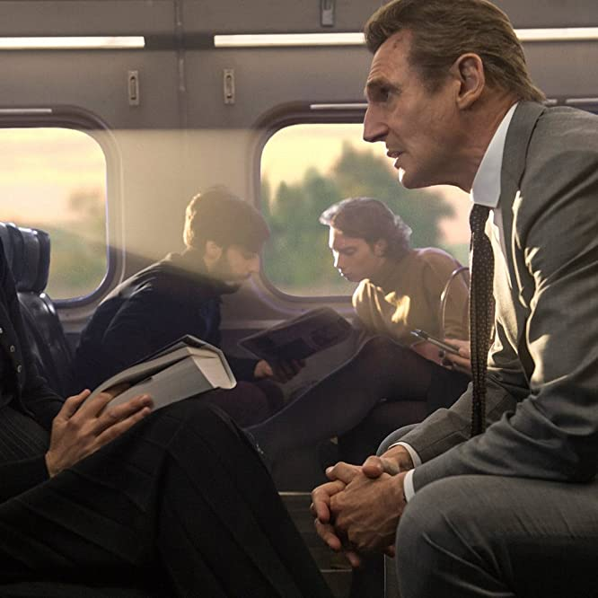 Liam Neeson and Vera Farmiga in The Commuter (2018)