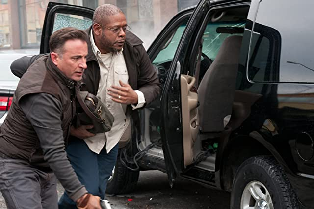 Andy Garcia and Forest Whitaker in A Dark Truth (2012)