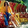George Harrison in Acapulco posing with colorful wooden lounge chairs, January 1977