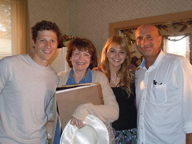 On the set of FRIDAY NIGHT LIGHTS with actors Zach Gilford and Aimee Teegarden and director Michael Waxman.