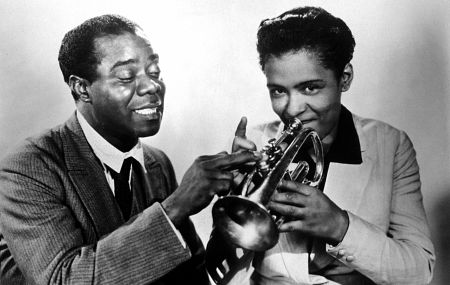 Louis Armstrong with Billie Holiday Dec. 1947.