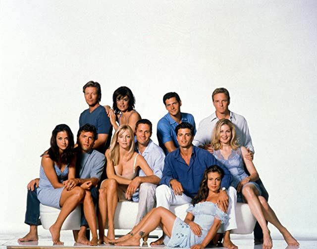 Heather Locklear, Alyssa Milano, Linden Ashby, David Charvet, Rob Estes, Lisa Rinna, Kelly Rutherford, Thomas Calabro, Andrew Shue, and Jack Wagner in Melrose Place (1992)