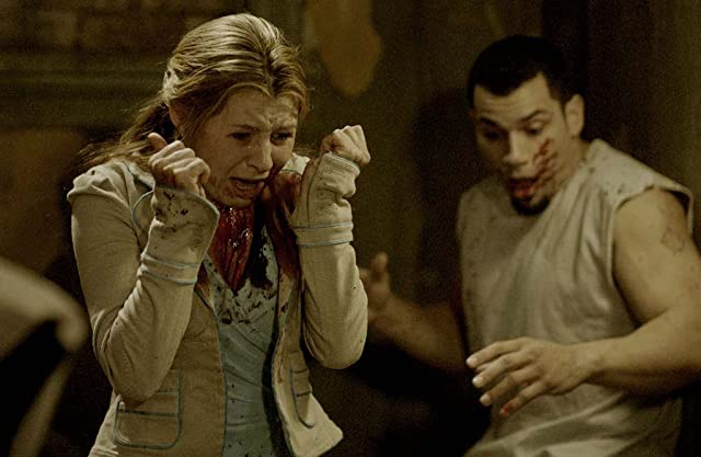 Beverley Mitchell and Franky G in Saw II (2005)