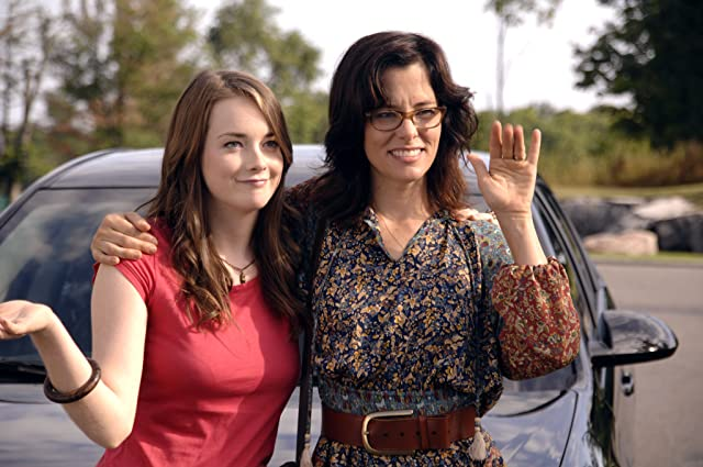 Parker Posey and Allie MacDonald in And Now a Word from Our Sponsor (2013)