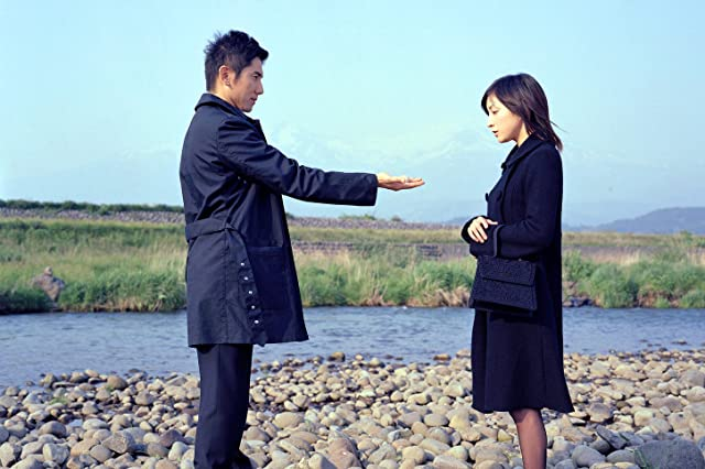 Ryôko Hirosue and Masahiro Motoki in Departures (2008)