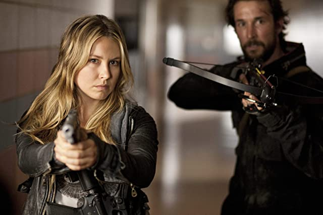 Noah Wyle and Sarah Carter in Falling Skies (2011)