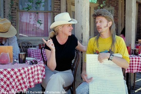 Director Dennie Gordon (left) and star David Spade discuss a scene