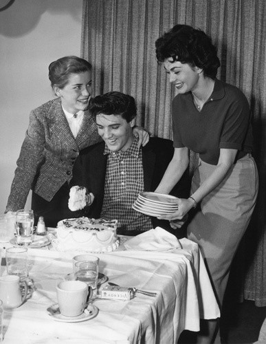 Elvis Presley with Dolores Hart and Valerie Allen at an Army Bond farewell party given by Hal Wallis during the making of