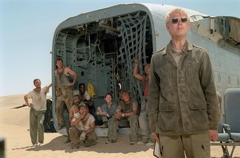 The mysterious and eccentric Elliott (Giovanni Ribisi, foreground) insists that he is the only hope for a group of passengers of a downed plane, including (left to right) Ian (Hugh Laurie), Towns (Dennis Quaid), AJ (Tyrese Gibson), Rady (Kevork Malikyan), Sammi (Jacob Vargas), Kelly (Miranda Otto), Liddle (Scott Michael Campbell) and Jeremy (Kirk Jones).