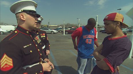 Marine recruiter in Flint, Mich. approaching teenagers outside a shopping mall to enlist them in the military.