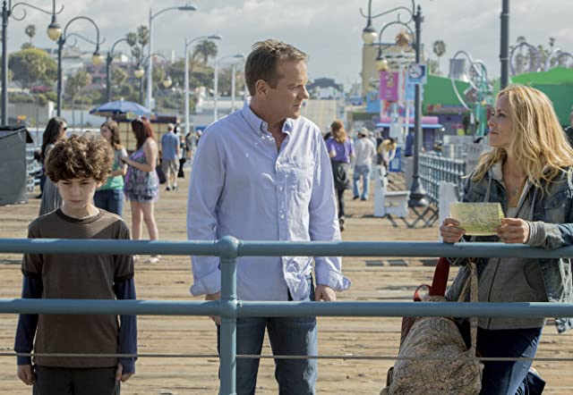 Kiefer Sutherland, Maria Bello, and David Mazouz in Touch (2012)