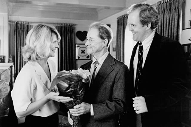 Don Ameche, John Lithgow, and Melinda Dillon in Harry and the Hendersons (1987)