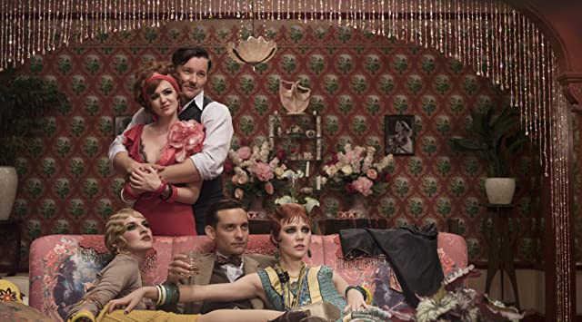 Tobey Maguire, Joel Edgerton, Isla Fisher, Kate Mulvany, and Adelaide Clemens in The Great Gatsby (2013)
