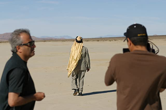 Producer Barry Navidi, Pacino in the b/g walking, filming Wilde Salome