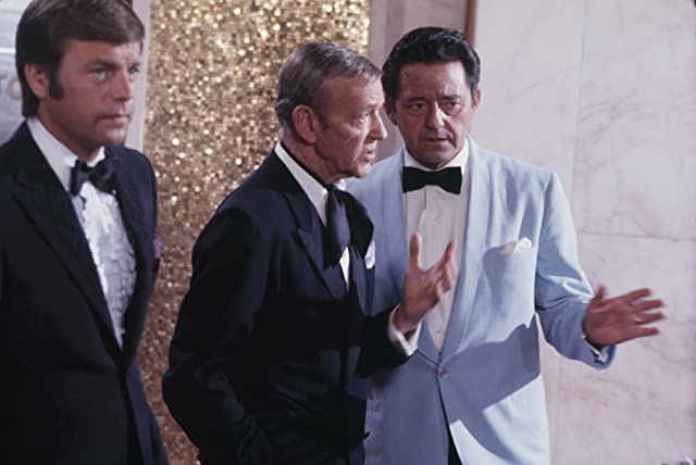 Fred Astaire, Robert Wagner, and Edward Binns in It Takes a Thief (1968)