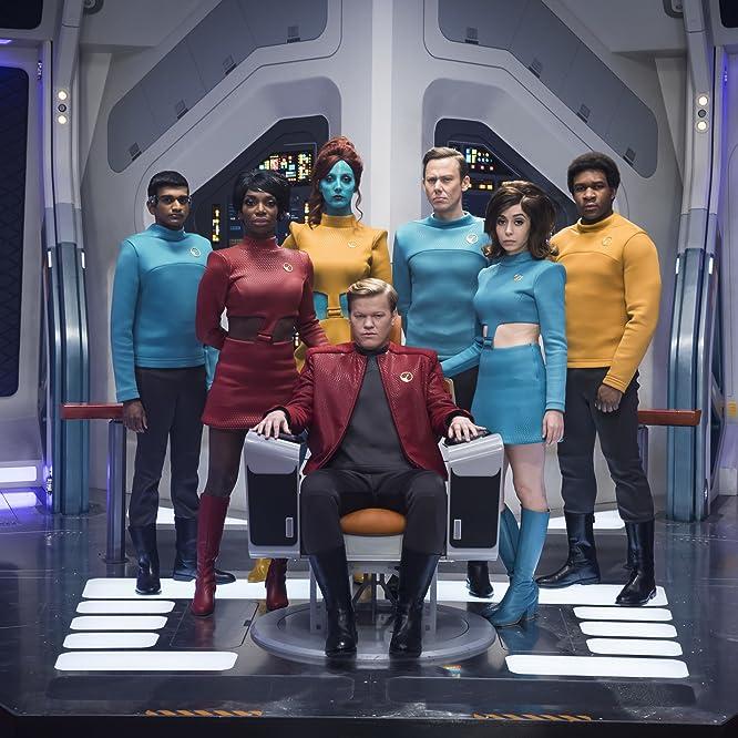 Jesse Plemons, Jimmi Simpson, Cristin Milioti, Milanka Brooks, Osy Ikhile, Michaela Coel, and Paul G. Raymond in Black Mirror (2011)
