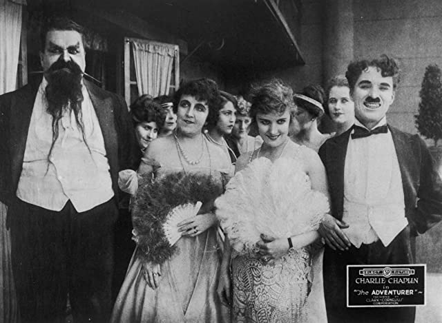 Charles Chaplin, Eric Campbell, Marta Golden, and Edna Purviance in The Adventurer (1917)