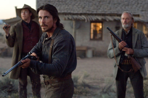 Christian Bale and Peter Fonda in 3:10 to Yuma (2007)
