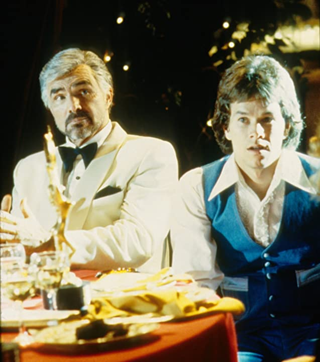 Mark Wahlberg and Burt Reynolds in Boogie Nights (1997)