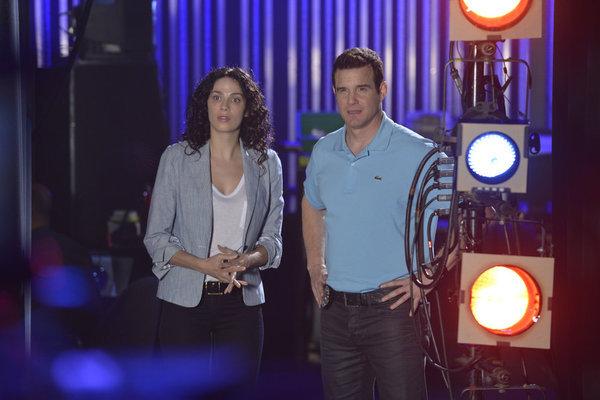 Eddie McClintock and Joanne Kelly in Warehouse 13 (2009)