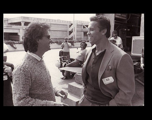 Director Mark L. Lester & Arnold Schwarzenegger on the set of