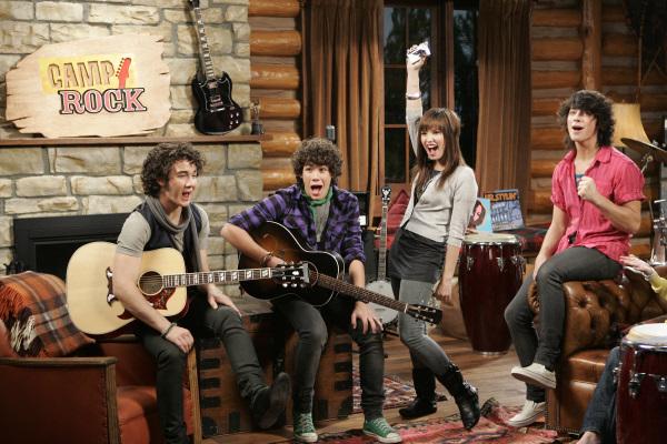 Demi Lovato, Kevin Jonas, Joe Jonas, and Nick Jonas in Camp Rock (2008)