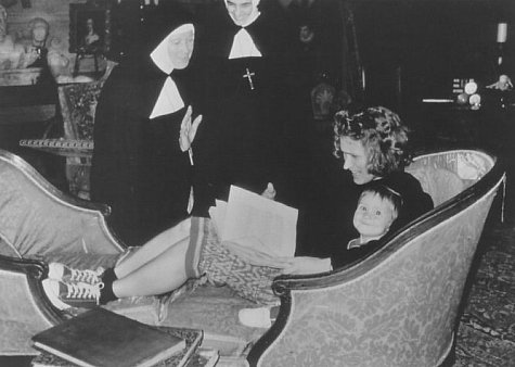 Director Jane Campion, with daughter, discusses a scene with two actresses.